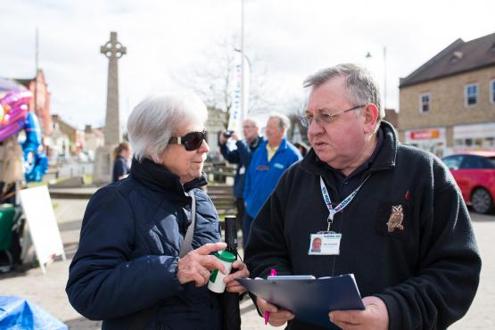 volunteers talking to public