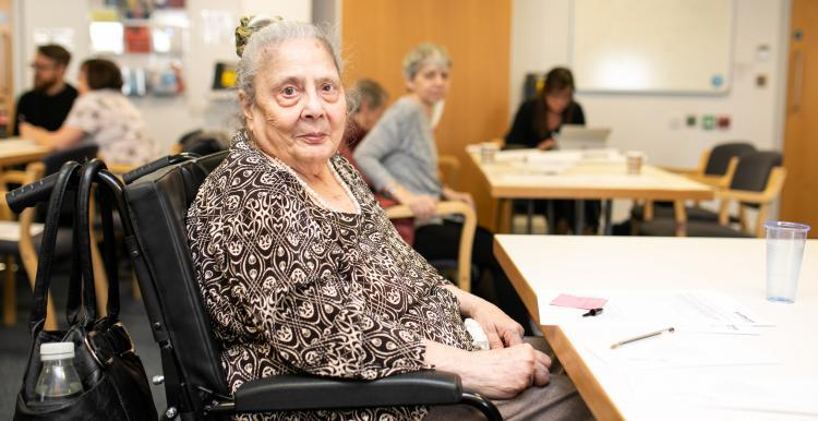 An elderly lady in a wheelchair