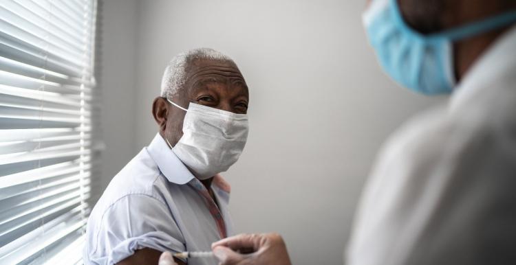 flu-covid-vaccine-vaccination-black-man
