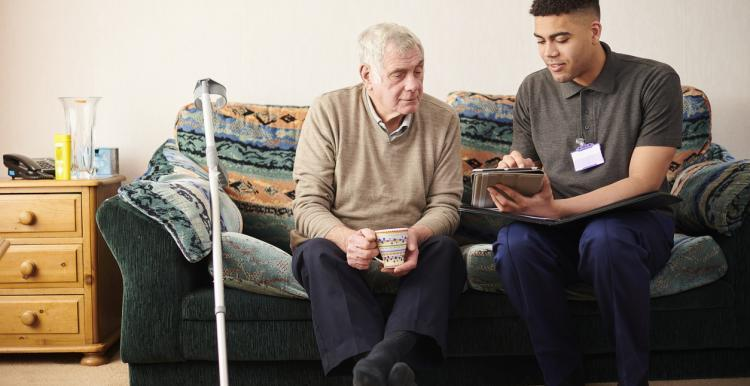 Man at home with a carer