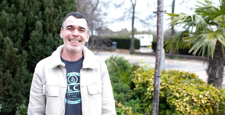 male volunteer standing on street