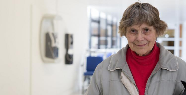 older woman alone in corridor