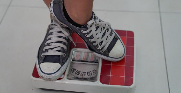 A pair of trainers standing on weighing scales