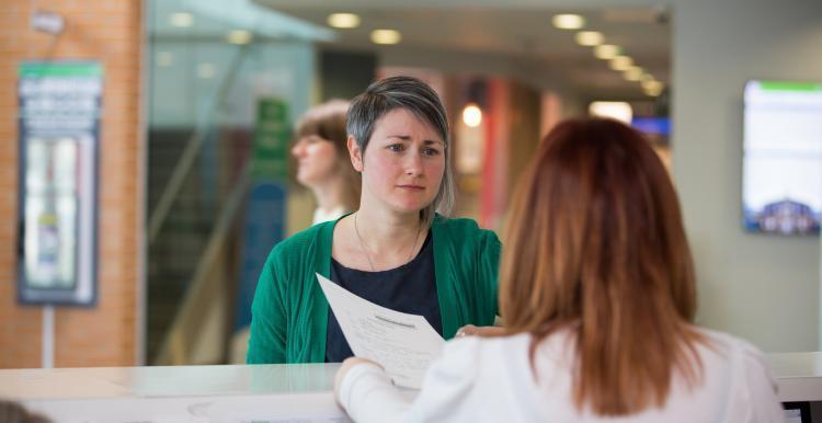 woman at GP reception