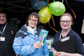 Healthwatch volunteer at an event speaking to the public