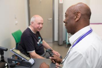 GP speaking to patient