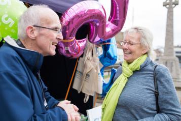 Two elderly people talking