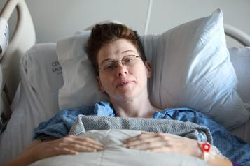 Woman in a hospital bed