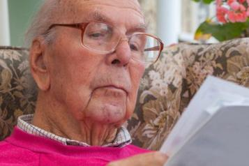 elderly man reading