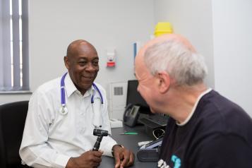 man at optician