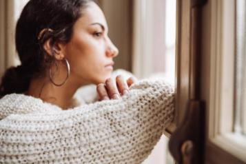 woman looking out of window