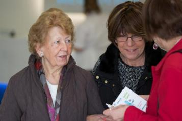 women talking to healthwatch representative