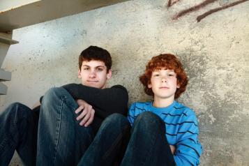 Boys sitting on floor